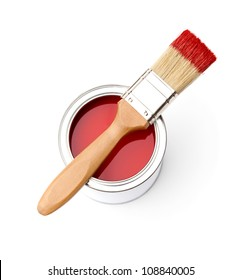 Full of red paint tin and paint brush on it, isolated on white