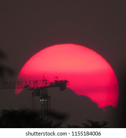 Full Red Sun with construction cranes. I took this pic on 30 April 2018 in Joburg, SA outside my apartment.
