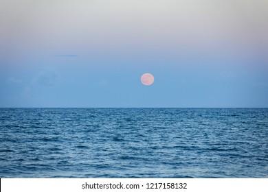 Full Rising Moon Over Ocean