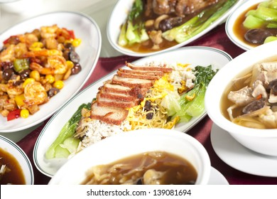 Full rounded table of Chinese food, noodle and pork