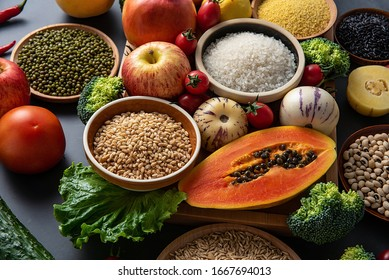 Full screen of fresh seasonal fruits and vegetables and whole grains