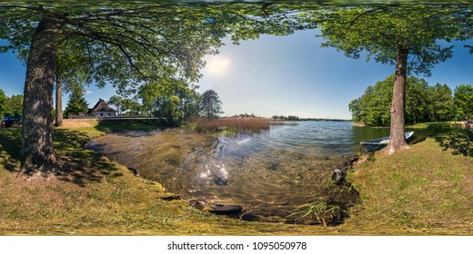 full seamless panorama 360 by 180 angle view on the shore of huge forest lake with a boat in sunny summer day in equirectangular projection, skybox VR virtual reality content