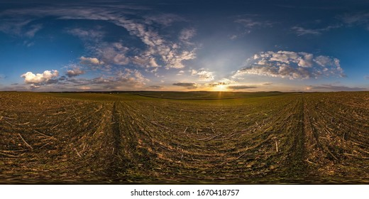 full seamless spherical hdr  panorama 360 degrees angle view among fields in evening sunset with awesome blue pink red clouds in equirectangular projection, ready for VR AR virtual reality