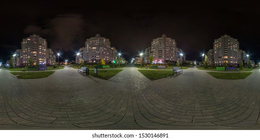 full seamless spherical hdri night panorama 360 degrees angle view on crossroads of pedestrian street with light in windows of multistory building area of urban development residential quarter