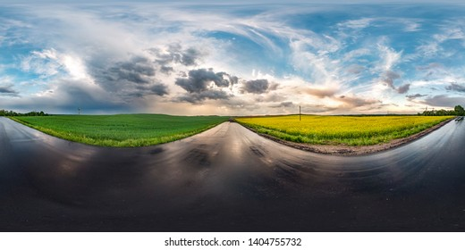 full seamless spherical hdri panorama 360 degrees angle view on wet asphalt road among canola fields in evening sunset after storm with awesome clouds in equirectangular projection,  VR AR content