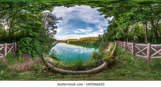full seamless spherical hdri panorama 360 degrees angle view on limestone coast of huge green lake or river near forest in summer day with beautiful clouds in equirectangular projection, VR content