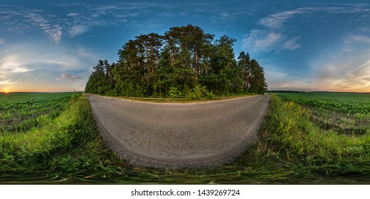 full seamless spherical hdri panorama 360 degrees angle view on gravel road among fields in summer evening sunset with awesome clouds in equirectangular projection, ready VR AR virtual reality content