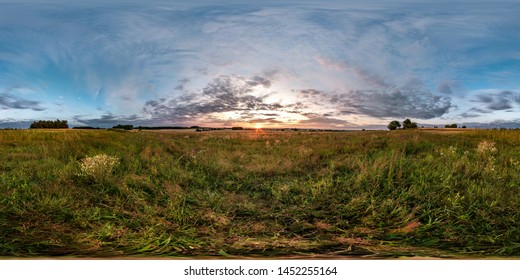 full seamless spherical hdri panorama 360 degrees angle view among fields in summer evening sunset with beautiful clouds in equirectangular projection with complete zenith