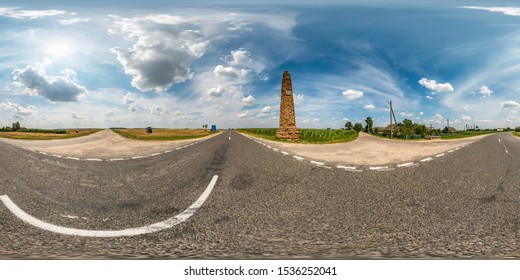 full seamless spherical hdri panorama 360 degrees angle view on asphault road near ancient stella in summer day with awesome clouds in equirectangular projection, for VR AR virtual reality content