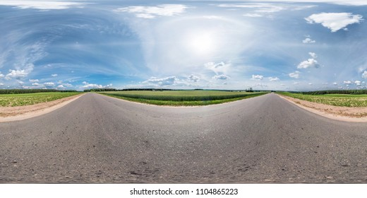 full seamless spherical panorama 360 by 180 degrees angle view on the asphalt road among fields in sunny summer day with halo in equirectangular projection, skybox VR virtual reality content