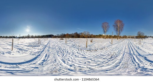 full seamless spherical panorama 360 by 180 degrees angle view on the snow covered field in sunny winter day with halo in equirectangular projection, skybox VR virtual reality content