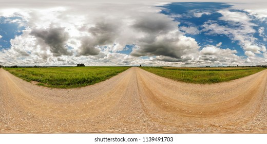 full seamless spherical panorama 360 by 180 degrees angle view on gravel road among fields in sunny summer day with awesome clouds in equirectangular projection, skybox VR virtual reality content