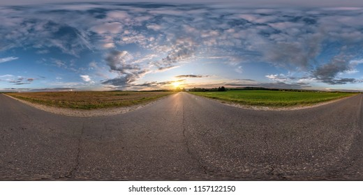 full seamless spherical panorama 360 degrees angle view on asphalt road among fields in summer evening sunset with awesome clouds in equirectangular projection, skybox VR AR virtual reality content