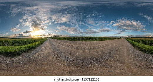 full seamless spherical panorama 360 degrees angle view on gravel road among fields in summer evening sunset with awesome clouds in equirectangular projection, skybox VR AR virtual reality content