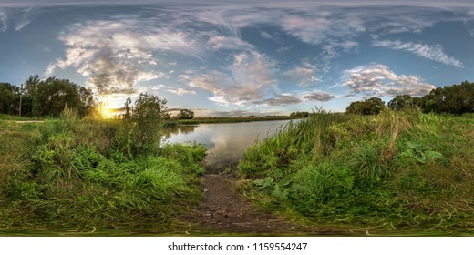 full seamless spherical panorama 360 by 180 angle view on the shore of small lake in sunny summer evening with awesome clouds in equirectangular projection, skybox VR virtual reality content