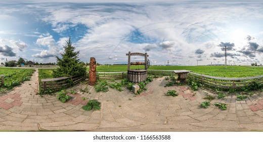 full seamless spherical panorama 360 by 180 angle view a place of rest with a well sump and wooden table in equirectangular projection, skybox VR virtual reality content