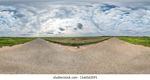full seamless spherical panorama 360 by 180 degrees angle view on gravel road among fields with awesome clouds in equirectangular projection, skybox VR virtual reality content