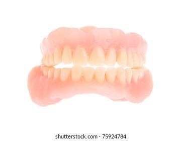 full set of a acrylic denture isolated on white background