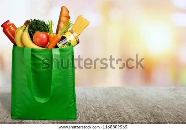 Full shopping  bag on desk