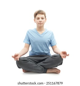 Full shot of a caucasian 12 years old children boy in a blue t-shirt doing yoga or stretches. Composition isolated over the white background