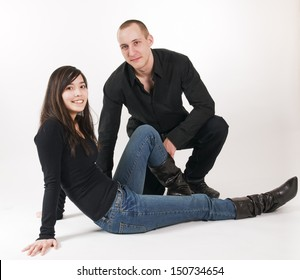 Full shot portrait of young couple on the bottom