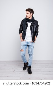 Full size, body portrait of stunning, perfect, stylish guy holding two hands in pocket of jeans, looking to the side, going for a walk, date, isolated on grey background