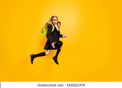 Full size photo of astonished child have bag backpack stylish trendy eyewear eyeglasses skirt scream isolated over yellow background