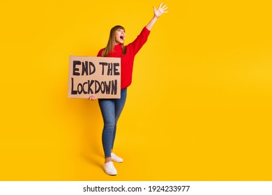 Full size photo of blond impressed lady stand with poster yell wear red sweater jeans sneakers isolated on bright yellow color background