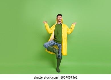 Full size photo of brunet optimistic guy do yoga wear cloak boots isolated on green color background - Shutterstock ID 1939059361