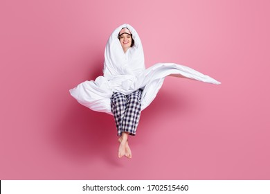 Full size photo of cheerful lady enjoy late morning sitting bed hug hold around head body warm blanket wear mask white plaid pajama pants barefoot isolated pink color background