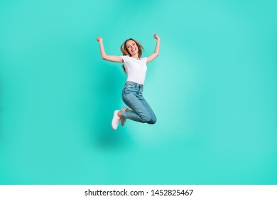 Full size photo of cute excited person raising fists screaming shouting yeah isolated over teal turquoise background