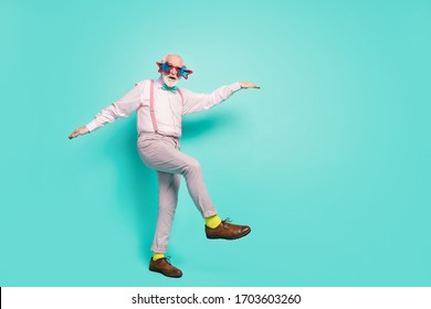 Full size photo of excited energetic old man enjoy dancing clubbing on vintage event concert wear good look shirt grey trousers brown footwear isolated over turquoise color background