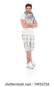 Full size portrait of good looking young man clothed for summer, looking at camera, isolated on white background.?