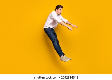 Full size profile photo of sad brunet millennial guy fall wear shirt jeans sneakers isolated on yellow background