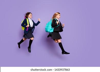 Full size profile side photo sweet kids run late elementary school wear skirt long socks stylish trendy isolated over purple violet background