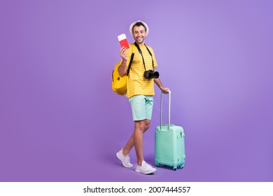 Full size profile side photo of young man happy positive smile travel abroad tickets bag isolated over violet color background - Shutterstock ID 2007444557