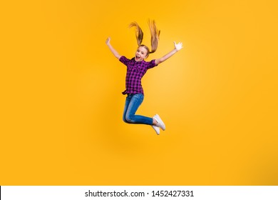 Full size side photo of small pupil jump high hooray holidays wear casual checkered shirt jeans denim isolated yellow background