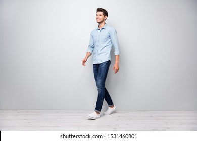 Full size turned photo of positive cheerful man have free time fun go walk want meet university friends wear casual style clothes isolated over grey color background