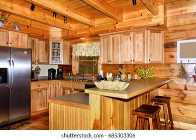 Full sized kitchen with bar area in cozy cabin in North Carolina