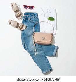 Full spring female look, sandals, jeans, handbag, shirt on white background