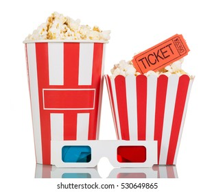Full striped box with popcorn, movie ticket and 3D glasses isolated on a white background