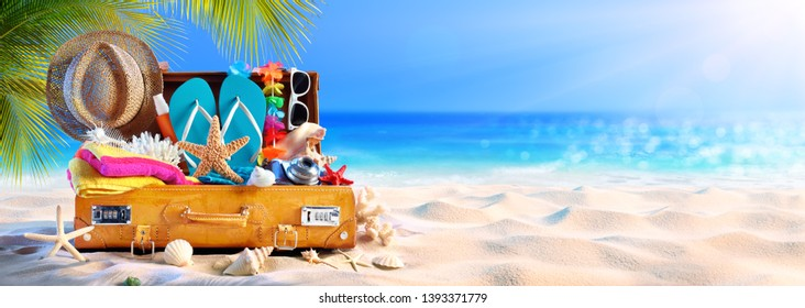 Full Suitcase With Accessories On Tropical Beach