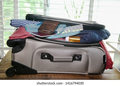 Full suitcase packed for vacation without more space