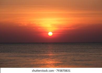 Full sun with sunset sky, sunset today and sunset tonight, sunset saturday in the Chaolao Beach Chanthaburi Thailand.