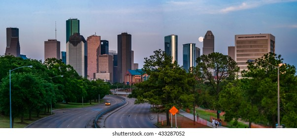 A full supermoon rising over Memorial Ave behind the Houston skyline in Houston, TX with all of the major Houston skyscrapers in view.