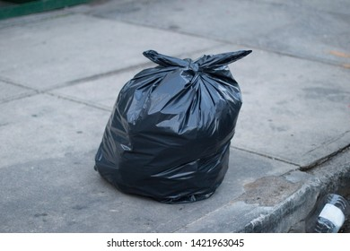 A full trash bag on the street in New York
