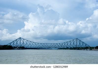 Full view of Howrah bridge in cloudy day. Howrah bridge is a cantilever bridge on Hooghly river, Kolkata.