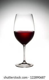 Full view image of red wine in a glass isolated on a  background