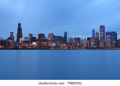 Full view of the Skyline of Downtown Chicago at dusk.
