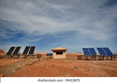 Full view of solar panels and building in desert